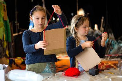 Girl holding up craft artwork