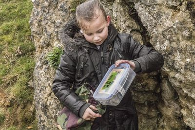 Child doing geocache trail