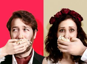 Two actors stuffing cake in their mouth
