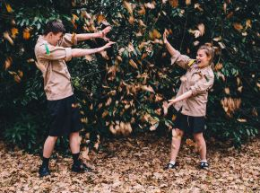 Adults throwing leaves